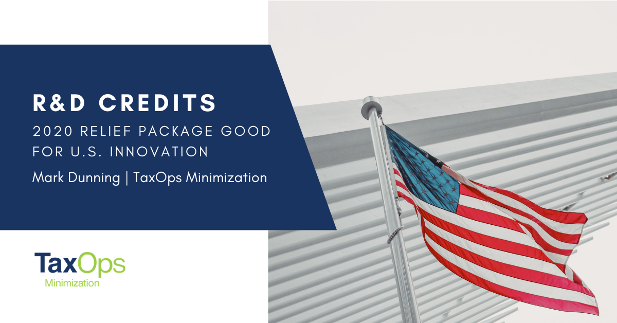 U.S. flag in front of business building, R&D credits provisions in year-end 2020 relief package good for U.S. innovation by Mark Dunning, lead partner at TaxOps Miniminization.